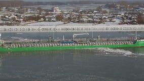 A tanker ship float between ice floes on the Danube near Tulcea, Romania. TULCEA, ROMANIA - JANUARY 9, 2017: A tanker ship float between ice floes on the Danube stock footage