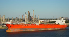 Tanker ship in front of an oil refinery Royalty Free Stock Photo