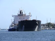Tanker ship maneuvering in the harbor Stock Photography