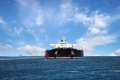 Tanker Ship. Oil tanker ship at sea on a background of blue sky Royalty Free Stock Image