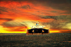 Tanker Ship. Oil tanker ship at sea on a background of sunset sky Royalty Free Stock Image