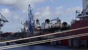 Tanker ship in operations at the Oil Terminal Stock Photo
