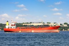 Tanker Ship. Red gas tanker sails in front of Topkapi Palace in Istanbul Stock Photography