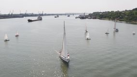 Tanker ship and sailboat on river. Aerial view. Sailboats and a tanker.  Royalty Free Stock Images