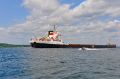 Tanker Ship and Speed Boat in the Thousand Islands Royalty Free Stock Photography