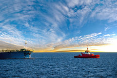 Tanker ship at sunrise Stock Images