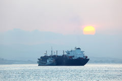 Tanker ship at sunset Stock Photos