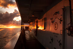 Tanker ship at sunset. Reflection and ray of sunset at oil tanker accommodation during sailing at sea royalty free stock image