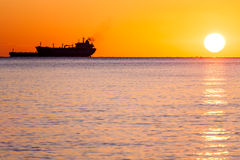 Tanker ship at sunset Royalty Free Stock Photography