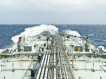 Tanker ship. Vlcc very large crude oil tanker on open rough sea Stock Photos