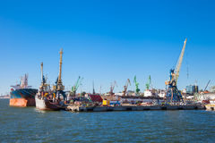 Tanker ship and working crane in Klaipeda, Lithuania. Royalty Free Stock Photos