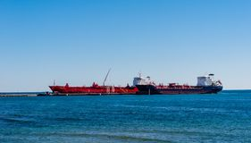 Tanker ships docked at lubricants plant on Lake Ontario. Royalty Free Stock Image