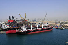 Tanker in shipyard. New building tankers in shipyard with cranes on background Royalty Free Stock Photo