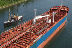 Tanker and steamboat on Kiel Canal Stock Images