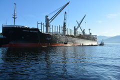 Tanker taking on cargo. In the north west pacific royalty free stock photography