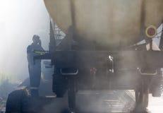 Tanker train insmoke firefighter Royalty Free Stock Photos