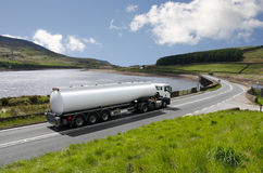 Tanker truck. Big fuel gas tanker truck on highway Royalty Free Stock Photos