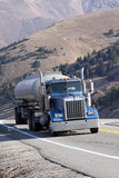 Tanker Truck. A fuel tanker semi truck navigates a high mountain road Royalty Free Stock Images