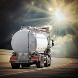 The tanker truck. Tanker truck against clouds of smoke. Ecology metaphor Royalty Free Stock Photography