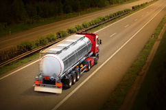 The tanker truck. Motion blurred tanker truck on the highway. Chemical industry and pollution concept Stock Photos
