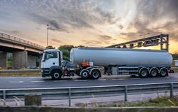 Tanker truck in motion on the motorway. With orange sky in the background royalty free stock image