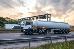 Tanker truck in motion on the motorway. With orange sky in the background royalty free stock photo
