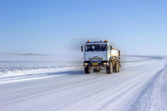 Tanker truck. Tanker truck moves down the road in the desert in the winter. Betpakdala, southern Kazakhstan Royalty Free Stock Photography