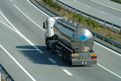 Tanker truck rolling on highway Stock Images
