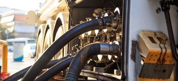 Tanker truck at the service station. Tanker truck filling up storage tank at the fuel station Stock Photos