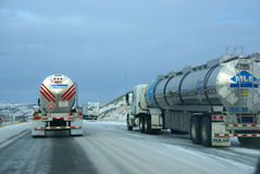 Tanker trucks on icy freeway Royalty Free Stock Photography