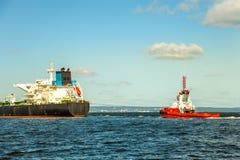 Tanker and tug Stock Image