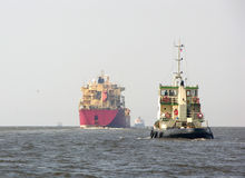 Tanker and tugboat. Russia royalty free stock photography