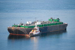 Tanker and a tugboat Stock Photography