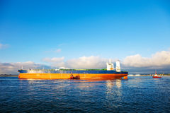 Tanker and tugs Stock Image