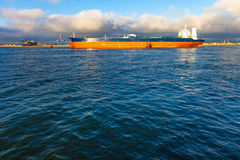 Tanker and tugs Royalty Free Stock Photos