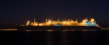 GAS CARRIER. Tanker at the wharf in the harbor at dawn Royalty Free Stock Photography