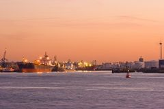 Tankers. Chemical tankers in port, getting loaded by evening light Stock Photos