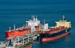 Tankers FPMC 17 and Alam Bistari near the oil terminal company Rosneft. Nakhodka Bay. East (Japan) Sea. 10.04.2014 Stock Images
