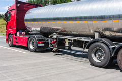 Tankers transporting fuel on the road. In summer Royalty Free Stock Image