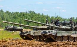 The tankman sits on the tank. Alabino, Russia - 18 june, 2015: The tankman sits on the tank. International Military Forum ARMY 2015 stock image