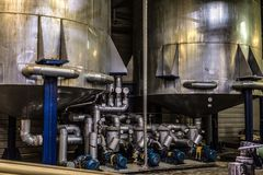 Tanks with air-injection equipment systems at an industrial plant. Industrial indoors view stock images