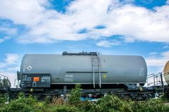 Tanks cargo with gas or oil transportation by railroad royalty free stock image