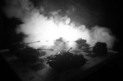 Tanks in the conflict zone. The war in the countryside. Tank silhouette at night. Battle scene. Royalty Free Stock Images