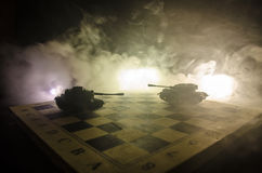 Tanks in the conflict zone. The war in the countryside. Tank silhouette at night. Battle scene. Royalty Free Stock Image