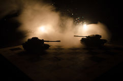 Tanks in the conflict zone. The war in the countryside. Tank silhouette at night. Battle scene. Stock Photos