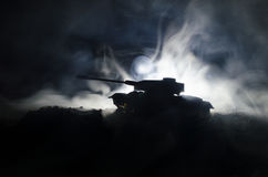 Tanks in the conflict zone. The war in the countryside. Tank silhouette at night. Battle scene. Stock Photo