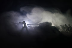 Tanks in the conflict zone. The war in the countryside. Tank silhouette at night. Battle scene. Royalty Free Stock Photo