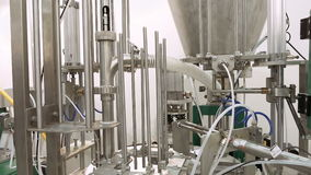 Tanks and containers with tubes and valves. Tanks and containers connected with tubes pipes and valves. Laboratory at food brewing production factory plant stock footage