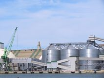 Tanks and crane. Steel tanks and crane in the harbour of Klaipeda Stock Photos