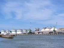 Tanks and cranes. Steel tanks and crane in the harbour of Klaipedas, Lithuania Stock Images
